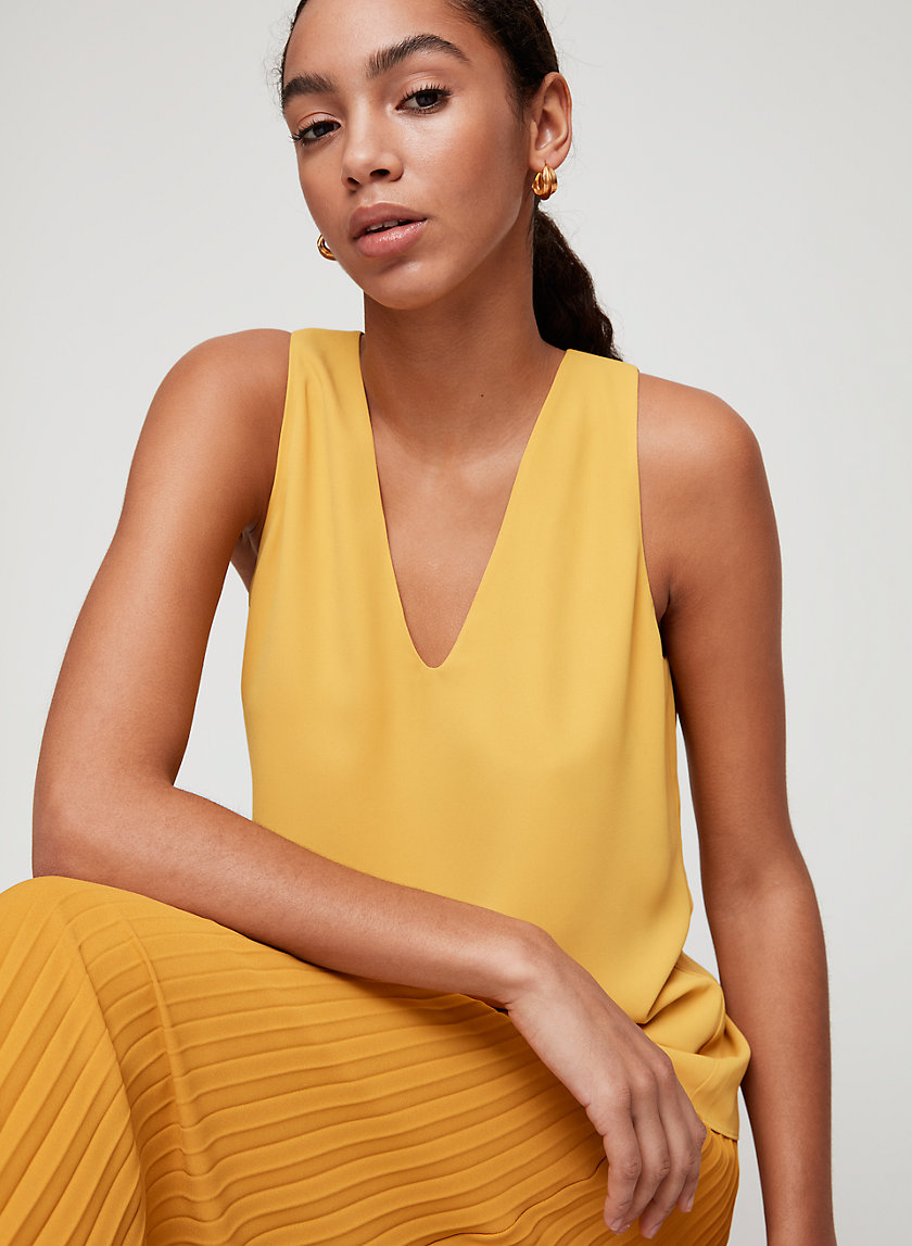 MADDOX BLOUSE - Sleeveless, back-slit top
